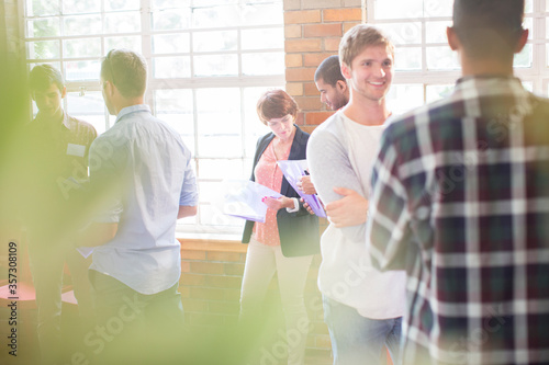 People networking at community center