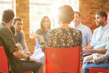 Woman Speaking In Group Therapy Session