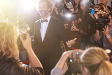 Smiling Celebrity Posing For Paparazzi Photographers At Event