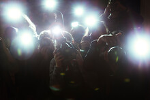 Close Up Of Paparazzi Photographers Pointing Cameras