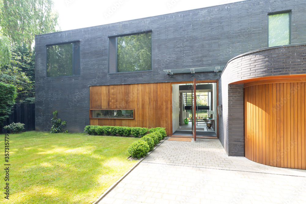 Fototapeta Modern home exterior with brick and wood