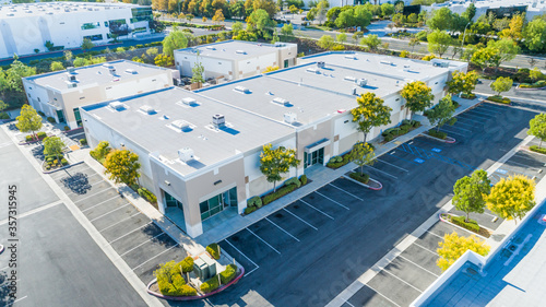 Obraz Aerial View Of Industrial Commerce Office Buildings - fototapety do salonu