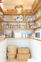 Woven Baskets And Food Jars In...
