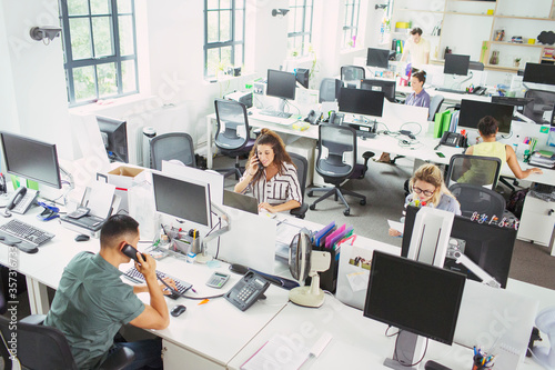 Business people working at desks in open plan office Canvas