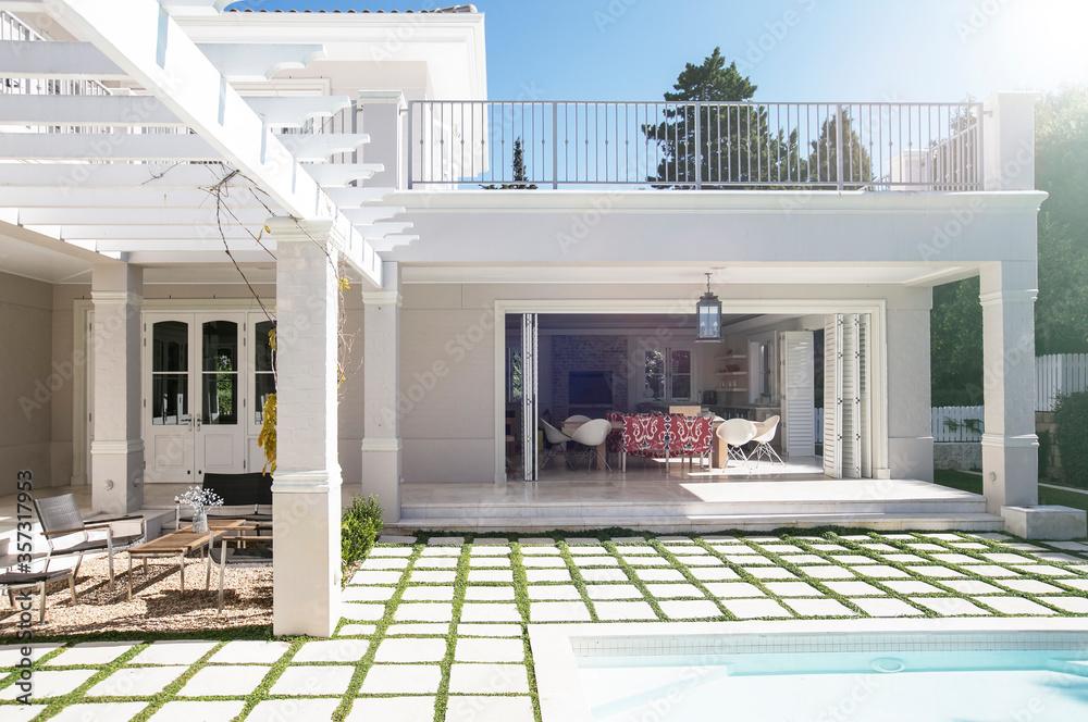 Fototapeta Paving stones at poolside patio of luxury house