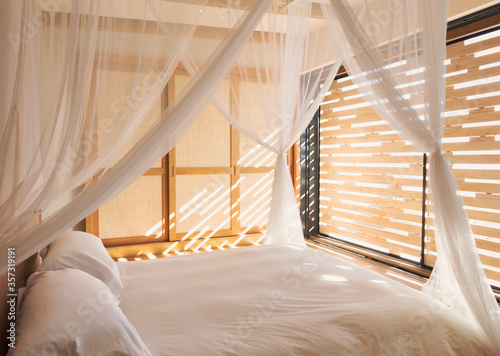White gauze curtains on canopy bed in tranquil modern, luxury home showcase inte Wallpaper Mural