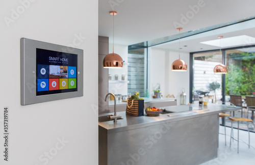 Photo Smart home navigation system on wall in kitchen