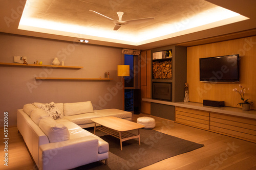 Photo Illuminated tray ceiling over home showcase living room
