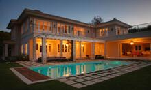 Illuminated Luxury House With Swimming Pool At Night