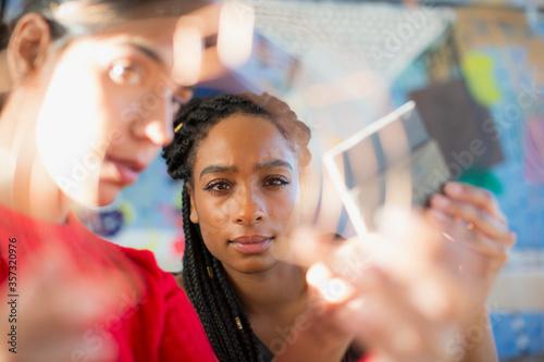 Focused female engineers examining prototype Tapéta, Fotótapéta