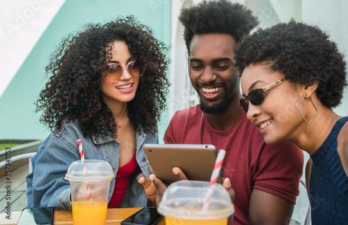 Fotografie, Obraz Three afro friends using digital tablet.