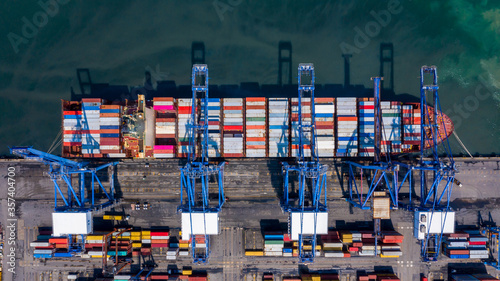 Container cargo ship at industrial port in import export global business worldwide logistic and transportation, Container ship unloading freight shipment, Aerial view container cargo boat freight Wallpaper Mural