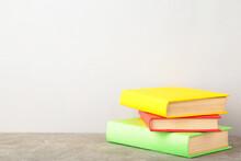 Multi Coloured School Books On Grey Background