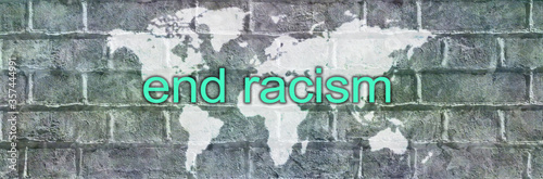 End racism campaign banner  - white world map graffiti on grey bricks with the w Fototapet