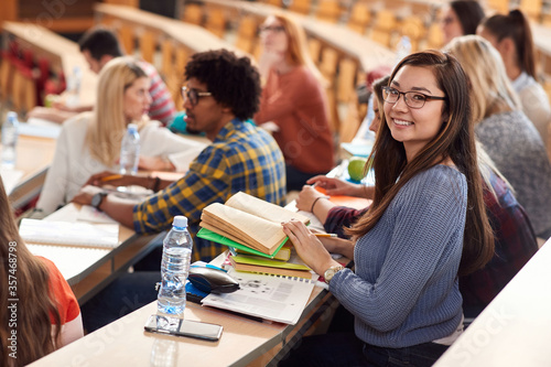 Fototapety, obrazy: Happy students smiling on lecture