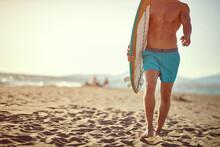 Man Surfers On A Beach. Portra...