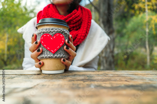Close up cozy cup with heart shape in hand on the nature Canvas Print