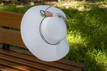 A Woman's White Straw Hat. Hea...