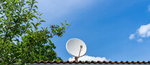 Satellite Dish On House Roof F...