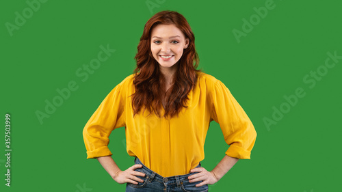 Positive Red-Haired Girl Posing Smiling To Camera Standing In Studio Canvas Print