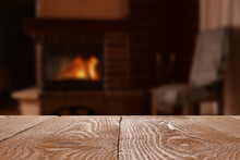 Rustic Table And Fireplace Wit...