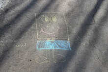 Mirny, Yakutia / Russia - 05.23.2020: Children's Drawing With Chalk On The Pavement.