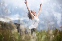Joyful Blonde Girl Enjoys Her Evening In The Countryside By Dancing In The Rain