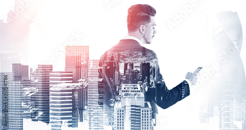 Businessman with smartphone in city Poster Mural XXL