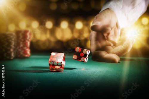 Man gambling at the craps table Wallpaper Mural