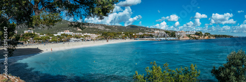 Beautiful sunny view of popular beach in Majorca, with the clean and blue water, in Balearic Islands, Spain