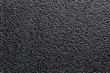 Flat Black Rugged Plastic Or Rubber Surface With Decorative Bumpy Finish