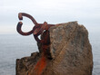 """Horizontal view of the sculpture """"Peine del Viento"""", with the Cantabrian Sea in the background on a winter day, San Sebastián, España"""