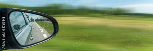 Fotografía Car driving on the road with motion blur background