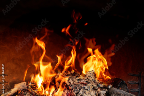 Wood burning in empty barbecue grill, outdoor fireplace grill