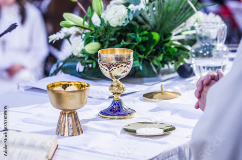 Obraz na plátne altar with host and chalice with wine in the churches of the pope of rome, franc