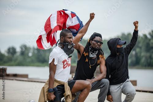 Fotografie, Tablou Portrait of three men protesting