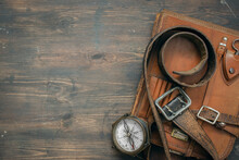 Compass And Old Leather Bag On...
