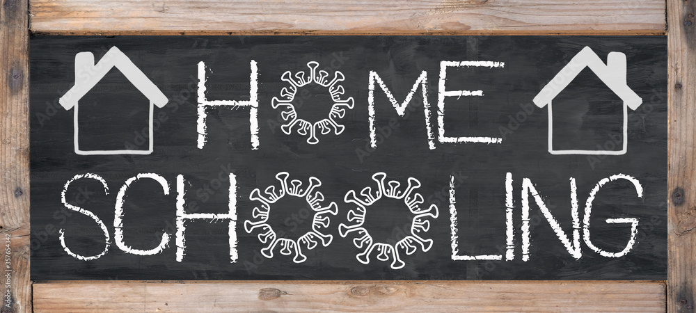 Fototapeta HOMESCHOOLING - Old rustic blackboard with wooden frame, white lettering and copy space