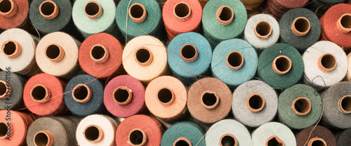 Valokuva Threads in a tailor textile fabric: colorful cotton threads, birds eye perspecti