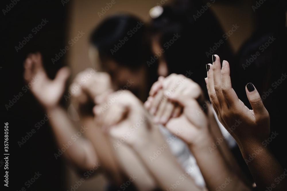 Fototapeta Group of people praying worship believe.