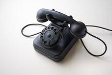 Old 1950s Bakelite Telephone Of 3/4 Left On White Background