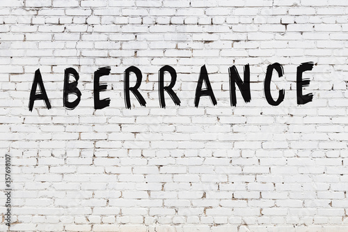 Word aberrance painted on white brick wall Wallpaper Mural