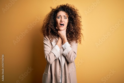 Young beautiful brunette woman with curly hair and piercing wearing casual t-shirt and diadem shouting and suffocate because painful strangle Canvas Print
