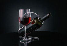 Holder With Bottle And Glass Of Wine On Dark Background