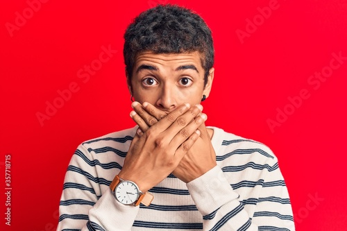 Fotografija Young african amercian man wearing casual clothes shocked covering mouth with hands for mistake