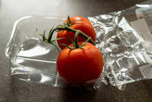Two Vine Tomatoes In Plastic P...