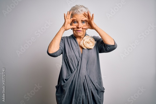 Obraz Senior beautiful grey-haired woman wearing casual dress standing over white background Trying to open eyes with fingers, sleepy and tired for morning fatigue - fototapety do salonu