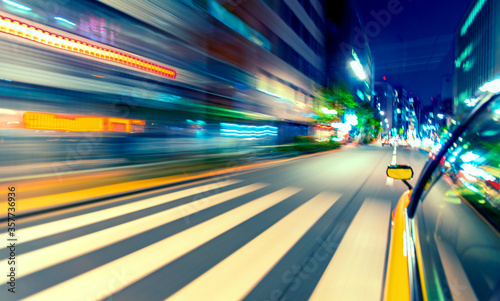 Valokuva Motion blurred drive through Tokyo, Japan at night