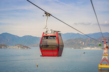 Beautiful Cableway On A Background Of Mountains And Sea. Cabin Cableway. Vacation Concept