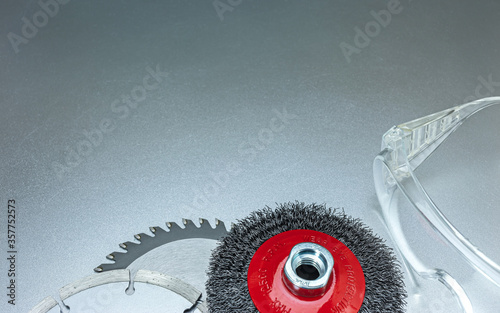 set of modern abrasive tools and protective safety glasses on grey metal surface Canvas Print